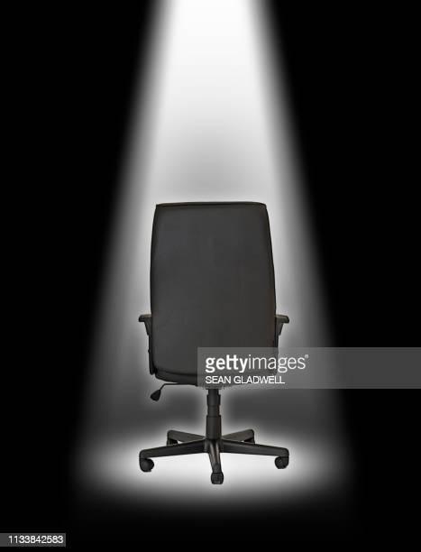 Office chair under spotlight