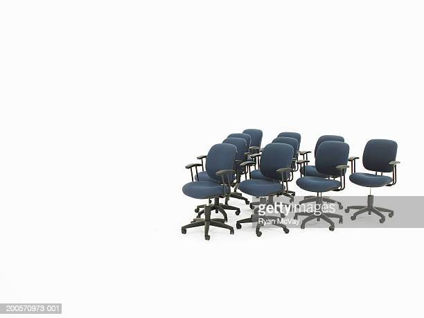 Office chairs forming triangle