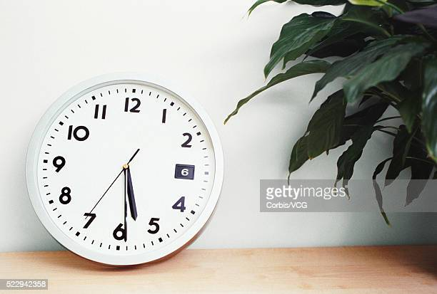 office clock - vcg stock pictures, royalty-free photos & images