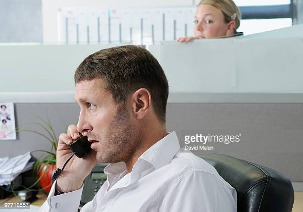 office colleague eavesdropping on conversation