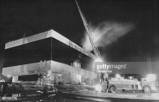 Office Complex Fire A ladder truck stands ready as firefighters combat a multialarm blaze inside the roof of an office complex at Academy Boulevard...