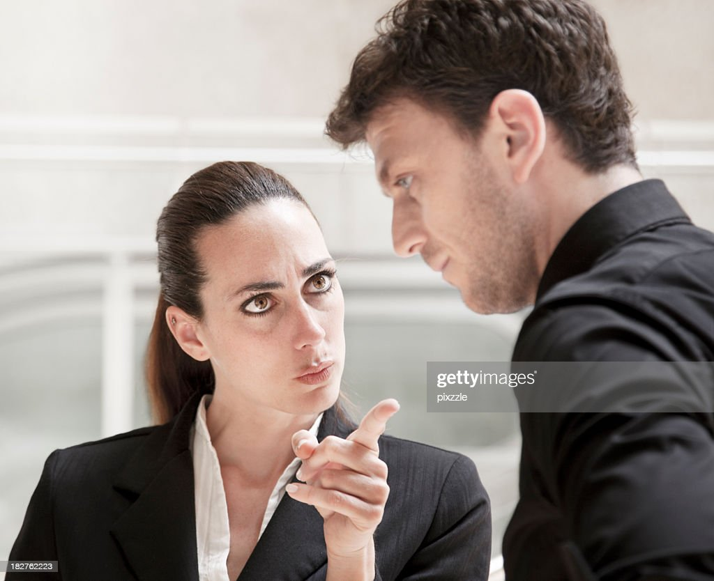 Office conflict business woman bully scolding and harrasing a worker : Stock Photo