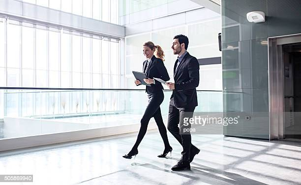 Office Corridor with elevator During Morning Rush Hour