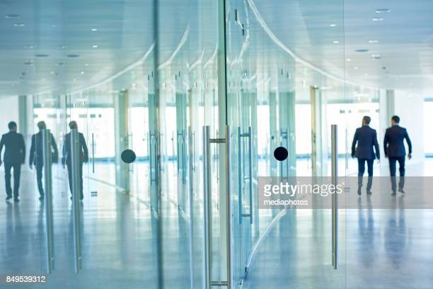 Office corridor with glassy walls