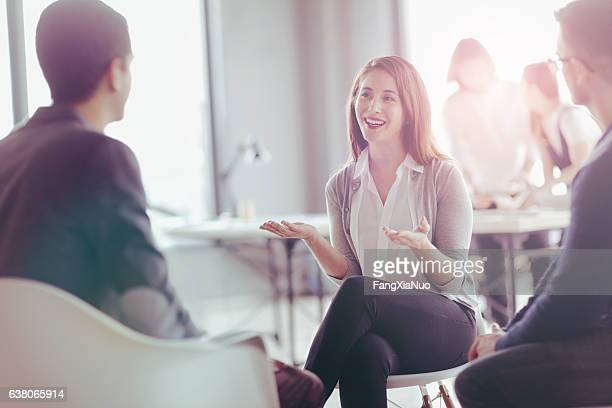 office coworkers talking during meeting together in design studio - solutions stock pictures, royalty-free photos & images