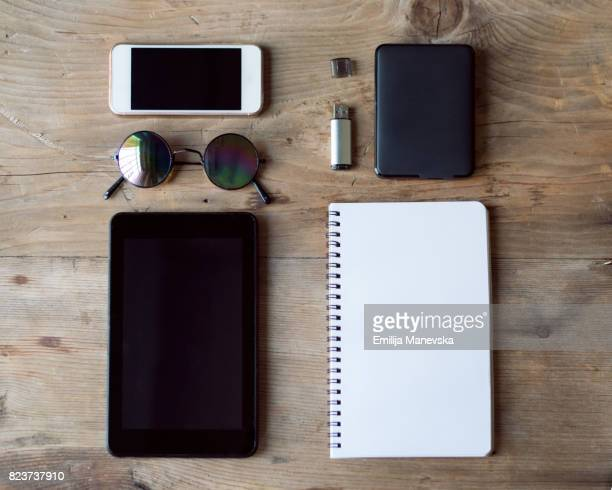 Office desk view, with digital tablet, mobile phone and blank notepad