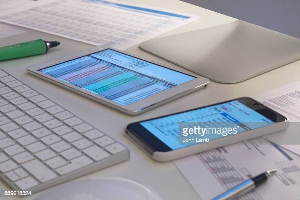 office desk with digital technology - financial technology stock photos and pictures