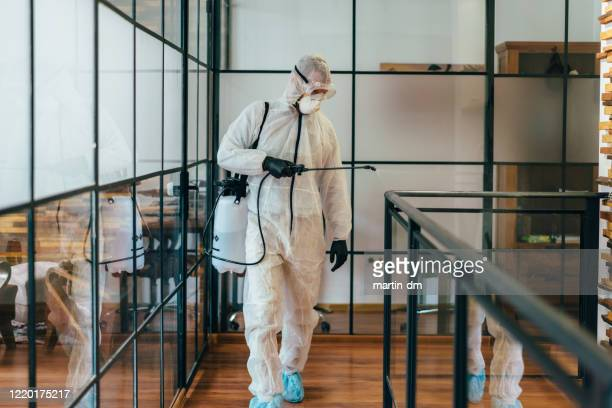 office disinfection during covid-19 pandemic - disinfection stock pictures, royalty-free photos & images