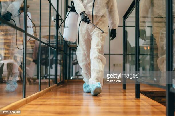 office disinfection during covid-19 pandemic,stopping the spread of the virus - disinfection stock pictures, royalty-free photos & images