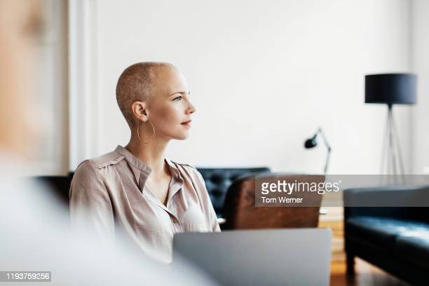 office employee listening during morning meeting - short hair stock pictures, royalty-free photos & images