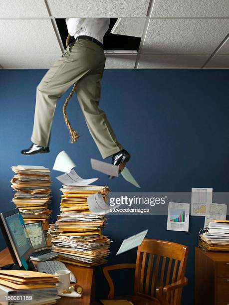 office escape through ceiling - escapism stock photos and pictures