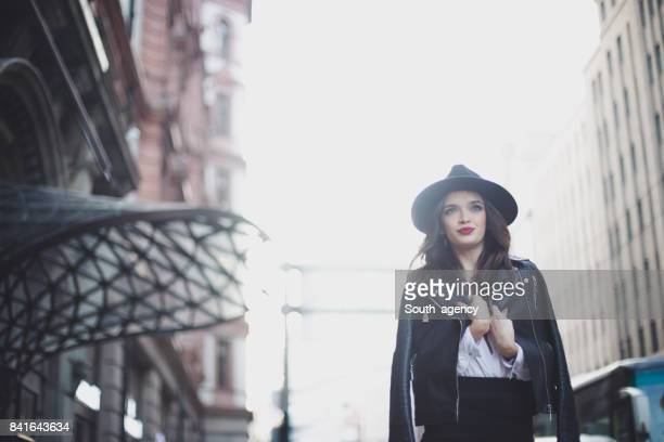 office girl with a biker jacket - biker jacket stock photos and pictures