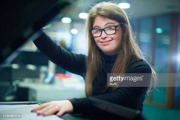 office junior portrait - down syndrome stock pictures, royalty-free photos & images