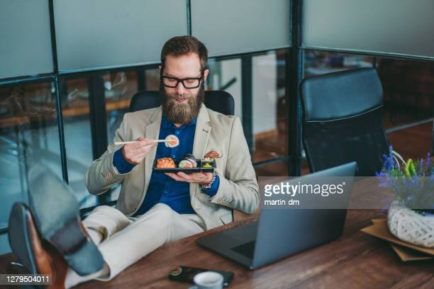 office lunch - legs crossed at ankle stock pictures, royalty-free photos & images