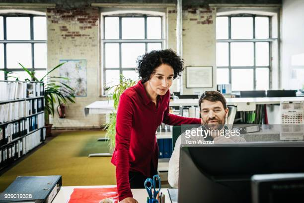 office manager assisting employee with problem - manager stock pictures, royalty-free photos & images