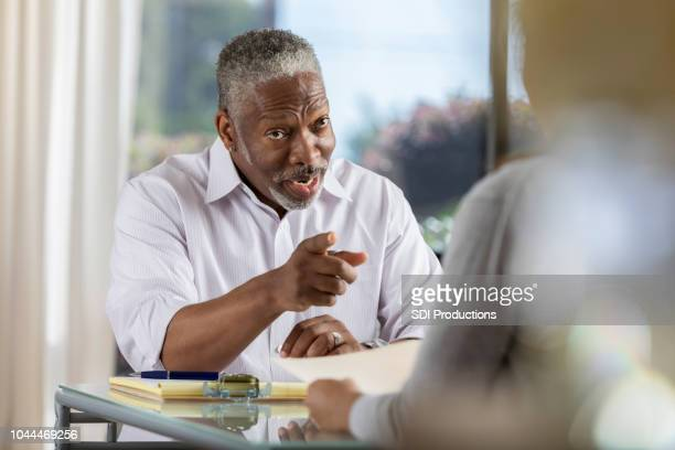 office manager has serious conversation with employee - scolding stock pictures, royalty-free photos & images