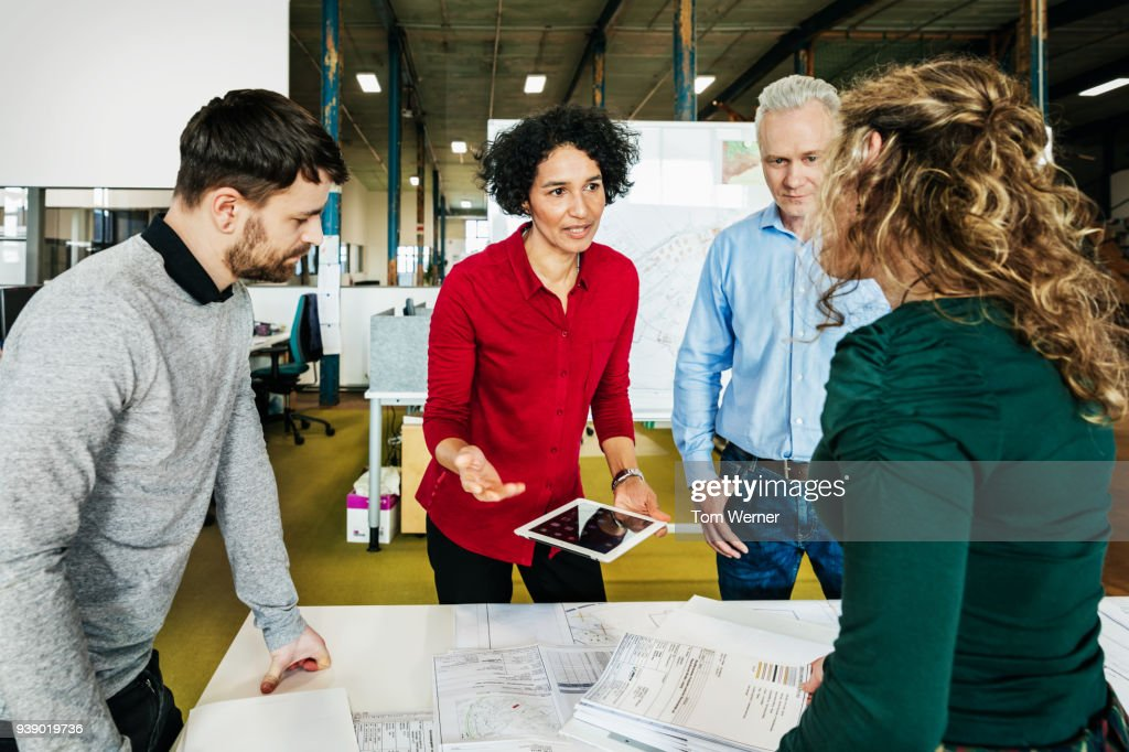 Office Manager Holding Meeting With Her Team : Stock Photo