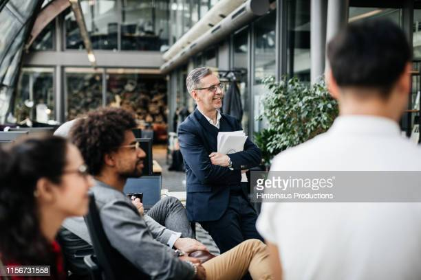 office manager listening to employee during meeting - employee engagement stock pictures, royalty-free photos & images