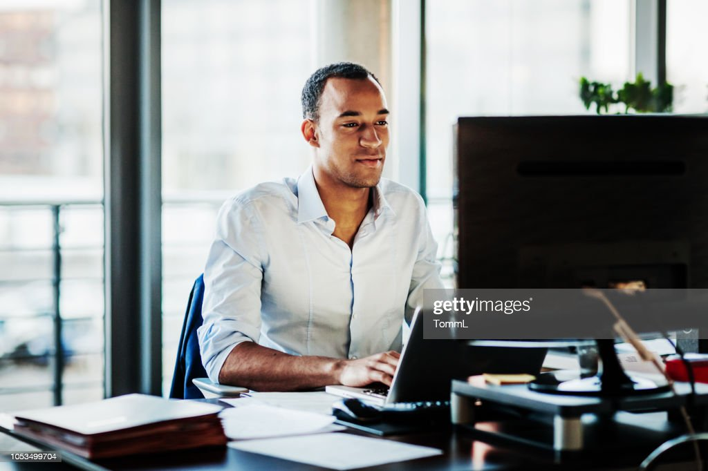 Office Manager Working On Computer At His Desk : Stock Photo