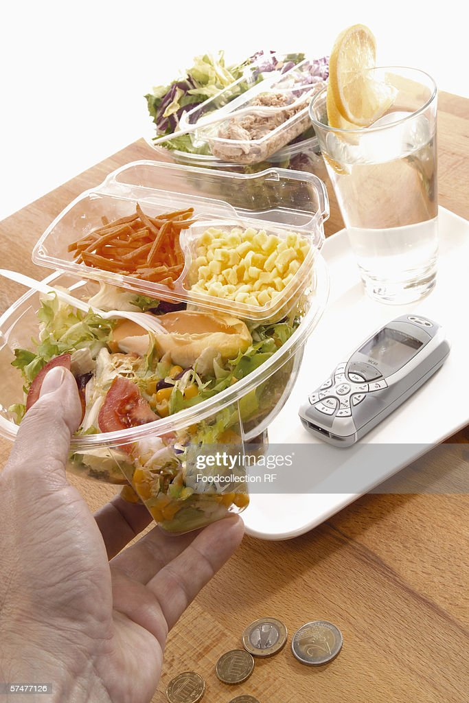 Office meal: ready-made salad in a plastic container : Stock Photo
