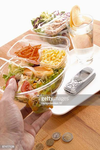 Office meal: ready-made salad in a plastic container
