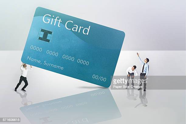 office men carrying a giant gift card - gift card imagens e fotografias de stock