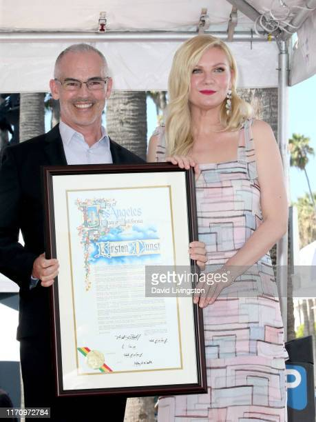Office of Councilmember Mitch O'Farrell 13th District and Kirsten Dunst attend the ceremony honoring Kirsten Dunst with a star on the Hollywood Walk...