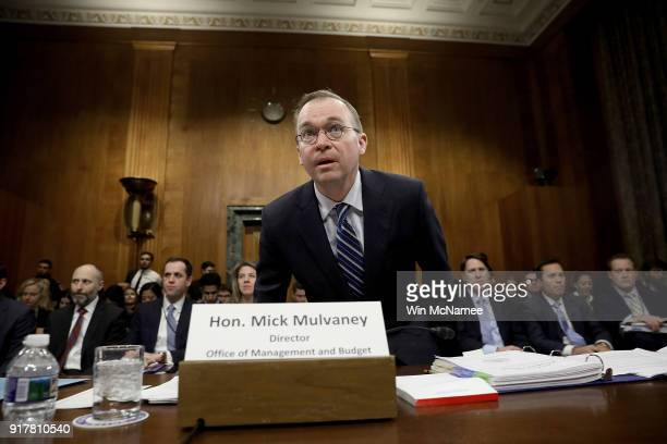 Office of Management and Budget Director Mick Mulvaney arrives for testimony before the Senate Budget Committee February 13 2018 in Washington DC...