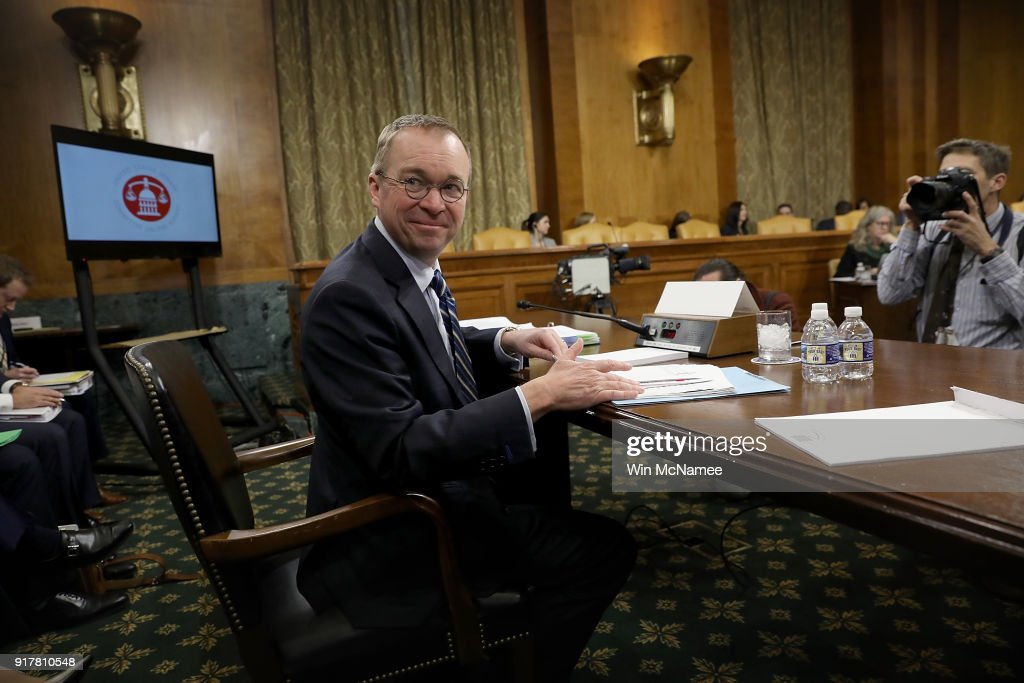 Office of Management and Budget Director Mick Mulvaney awaits the start of a hearing held by the Senate Budget Committee February 13, 2018 in Washington, DC. Mulvaney testified on U.S. President Donald Trump's fiscal year 2019 budget proposal that was released yesterday.