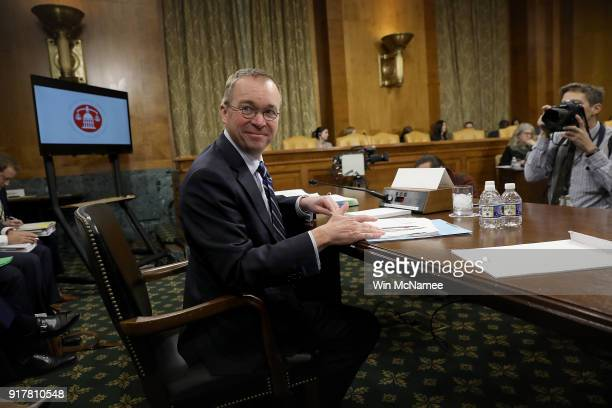 Office of Management and Budget Director Mick Mulvaney awaits the start of a hearing held by the Senate Budget Committee February 13 2018 in...