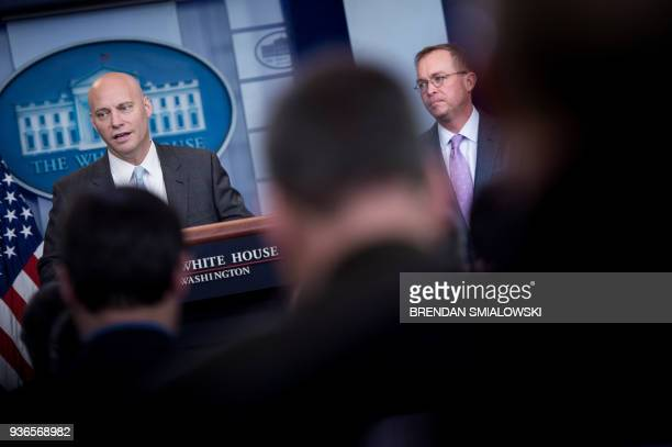 Office of Management and Budget Director Mick Mulvaney listens while Director of Legislative Affairs Marc Short speaks about the Consolidated...