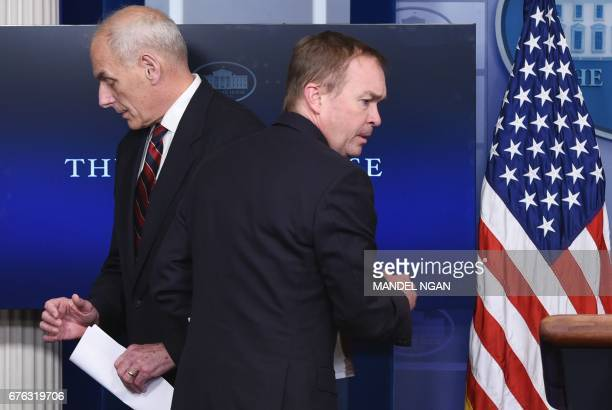 Office of Management and Budget Director Mick Mulvaney passes Homeland Security Secretary John Kelly as he makes his way to the podium in the Brady...