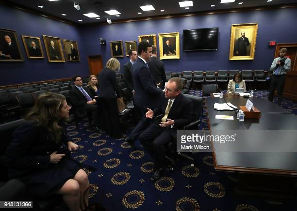 Office of Management and Budget Director Mick Mulvaney prepares to testify to a House Appropriations Committee on Capitol Hill April 18 2018 in...