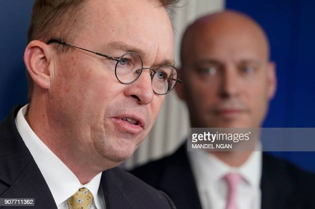 Office of Management and Budget Director Mick Mulvaney speaks as Legislative Affairs Director Marc Short looks on during a press briefing in the...