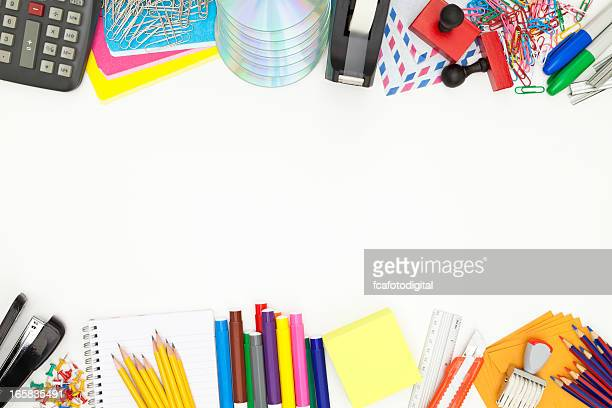 Office or school supplies border shot directly above