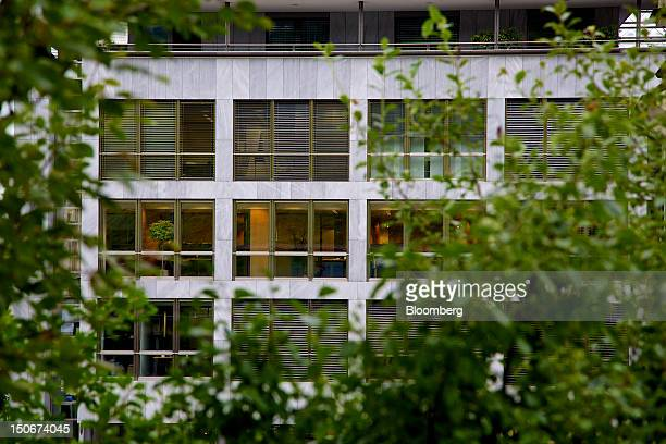 Office rooms are illuminated inside the building that houses the headquarters of Xstrata Plc in Zug, Switzerland, on Friday, Aug. 24, 2012....