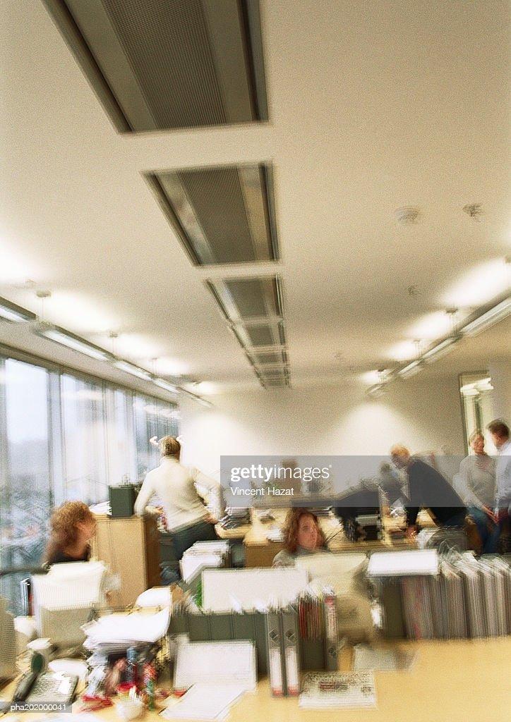 Office setting, blurred. : Stockfoto