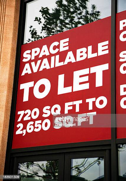 Office space to let sign on commercial building