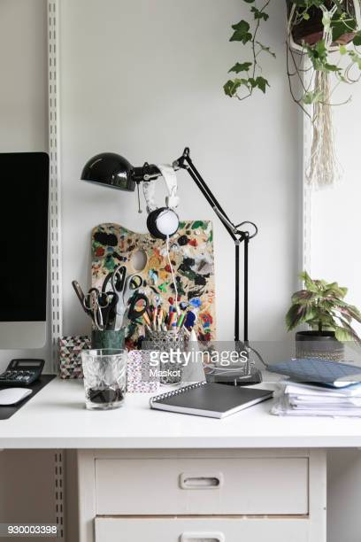 office supplies on desk at home - angle poise lamp stock pictures, royalty-free photos & images
