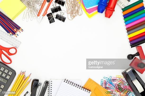 Office supply border shot directly above on white background