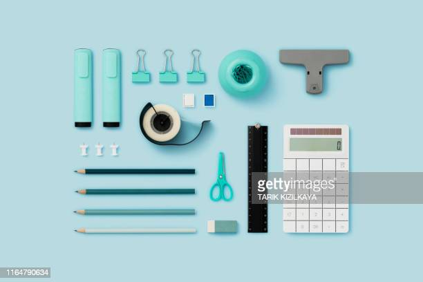 office supply flat lay on blue background - stationary stock pictures, royalty-free photos & images