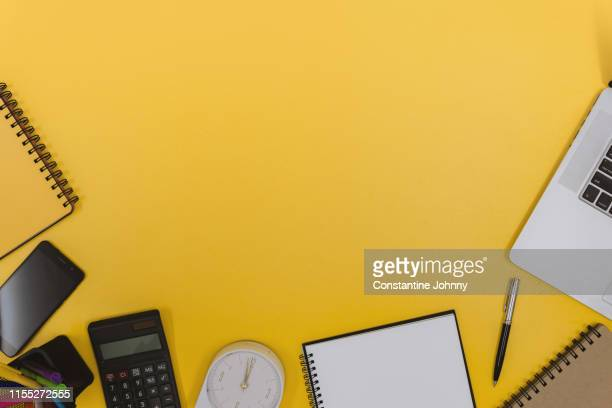office supply items on yellow work desk - group of objects stock pictures, royalty-free photos & images