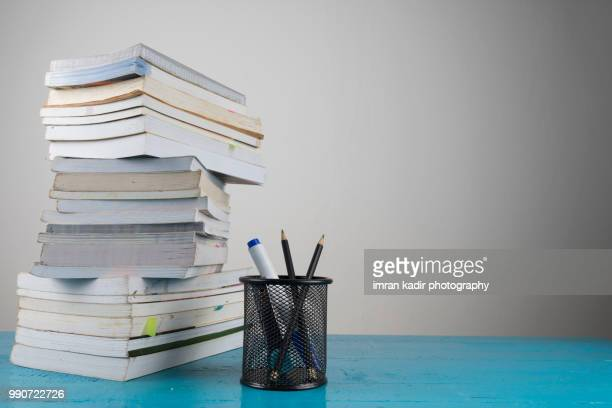 office table concept - textbook stock pictures, royalty-free photos & images