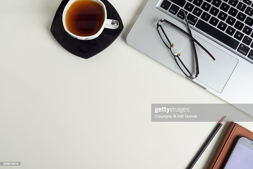 table top view. Office Table Top View Shot With Laptop Keyborad, Tea Cup, Mobile Phone, Pencil