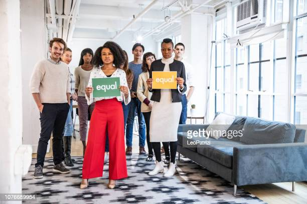 office team people standing for equal rights and justice - preconceito racial imagens e fotografias de stock