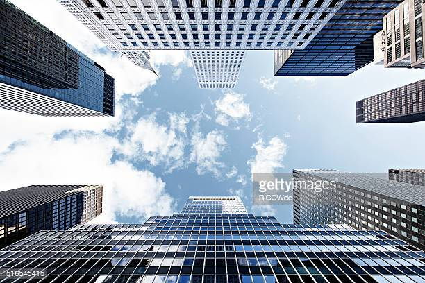 office tower in new york city - low angle view stock pictures, royalty-free photos & images