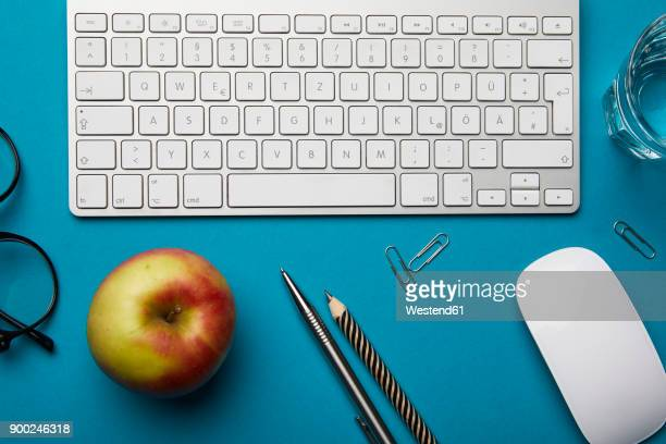 office utensils on desk - ballpoint pen stock photos and pictures