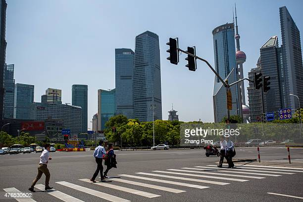 Office white collars walk past a crossroad in Lujiazui Located in the Pudong New District on the eastern bank of Huangpu River Lujiazui is the...