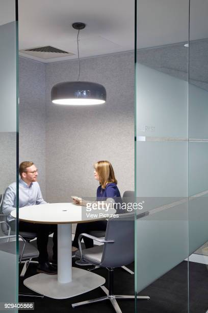 Office with with large pedant light and people chatting Office Space at The Gherkin London United Kingdom Architect IOR GROUP Interiors Foster...