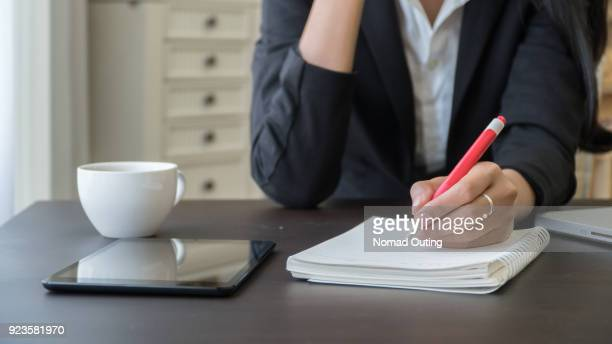 office wokeplace environment,woman working with documents. - list stock pictures, royalty-free photos & images